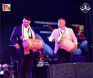 Igor Mazurenko and Kirill Yakovlev playing the Dhol (drum)